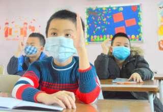 Học sinh trường Pascal, Hà Nội đeo khẩu trang trong lớp ngày 30/1. Ảnh: Xuân Quang
